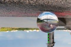 在桥梁背景的玻璃透明球和 图库摄影