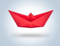 在梯度背景的红色origami纸船 免版税图库摄影