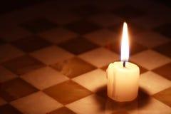在棋枰的蜡烛 库存照片