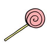 在棍子的焦糖糖果 孩子和广告的一个经典纤巧 免版税库存照片