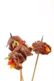 在棍子的肉开胃菜 免版税库存图片