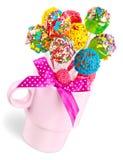在棍子花束的甜棒棒糖在有弓的花瓶 免版税库存图片