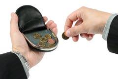 在棕榈的变动钱包,拿着一枚硬币 库存图片