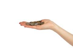 在棕榈的硬币 免版税库存图片