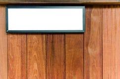 在棕色木板背景的画框 免版税库存照片