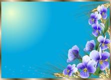 在棕色框架的蓝色花 免版税库存图片