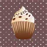 在棕色背景的巧克力杯形蛋糕 图库摄影