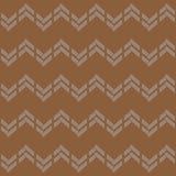 在棕色背景的无缝的抽象Z形图案 库存图片