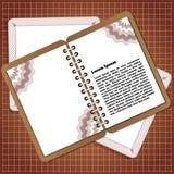 在棕色背景的笔记薄 免版税库存图片