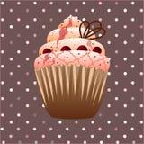 在棕色背景的蔓越桔杯形蛋糕 图库摄影