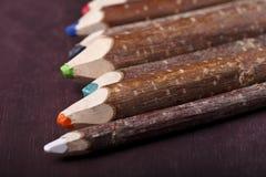 在棕色背景的装饰铅笔 免版税库存照片