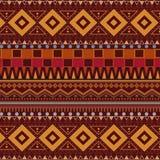 在棕色背景的部族种族无缝的样式 免版税库存照片