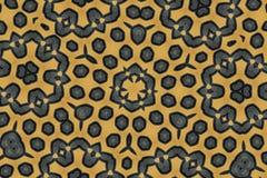 在棕色背景的黑六角形纹理 免版税库存图片
