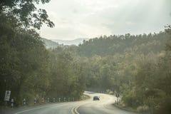 在森林背景附近的路高速公路 泰国旅行 库存照片