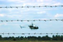 在森林附近的直升机飞行 图库摄影