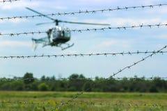 在森林附近的直升机飞行 库存照片
