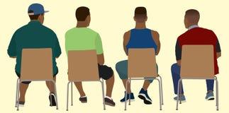 从在椅子的后面开会观看的黑人 免版税库存照片