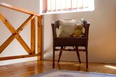 在椅子的女用连杉衬裤熊 免版税库存照片