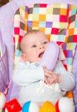 在椅子的婴孩 图库摄影