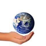 在概念地球现有量附近拯救世界 图库摄影