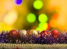 在模糊的光背景的圣诞节装饰 免版税图库摄影