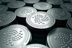 在模糊的特写镜头的IOTA硬币 新的cryptocurrency和现代银行业务概念 库存例证