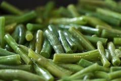 在橄榄油的油煎的青豆 免版税图库摄影