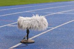 在橄榄球场附近的职业体育话筒 免版税库存图片