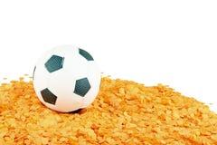 在橙色五彩纸屑的足球 库存图片