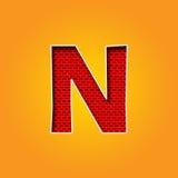 在橙色和黄色颜色字母表的唯一字符N字体 图库摄影
