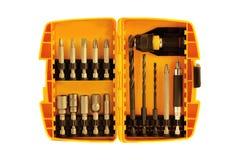 在橙色塑料盒的钻头 免版税库存照片