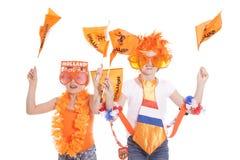 在橙色成套装备的两个荷兰支持者 免版税库存图片