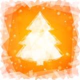 在橙色方形的背景的冻圣诞树 免版税库存照片