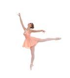在橙色礼服的一个年轻人和适合女性跳芭蕾舞者 库存照片