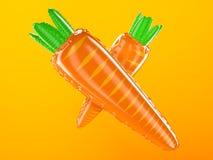 在橙色背景的可膨胀的红萝卜 免版税库存图片