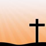 在橙色背景的基督徒十字架 免版税库存照片