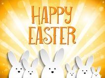 在橙色背景的愉快的复活节兔子兔宝宝 库存照片