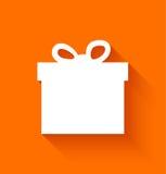 在橙色背景的抽象圣诞节礼物盒 免版税图库摄影