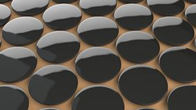 在橙色背景的空白的黑徽章 免版税库存图片