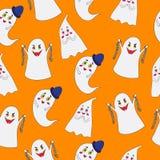 在橙色背景的鬼魂样式 免版税库存图片