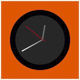 在橙色背景的黑和灰色圆的时钟 免版税图库摄影