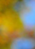 在橙色金子和蓝色的抽象心情背景 免版税图库摄影