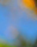 在橙色金子和蓝色的抽象心情背景 免版税库存图片