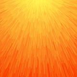 在橙色颜色的能量轻的抽象背景 免版税库存照片