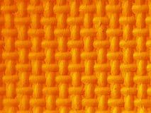 在橙色3d的塑料图与纹理 免版税库存图片