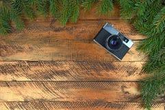 在欢乐背景的照相机 圣诞节 技术 免版税库存照片