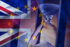 在欧洲和英国旗子附近的Sandglass 库存照片