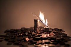 在欧洲硬币的灼烧的比赛 库存照片