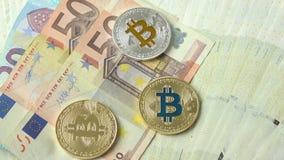 在欧洲货币背景的Bitcoins特写镜头 股票录像