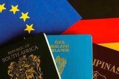 在欧洲和德国旗子的护照 库存图片